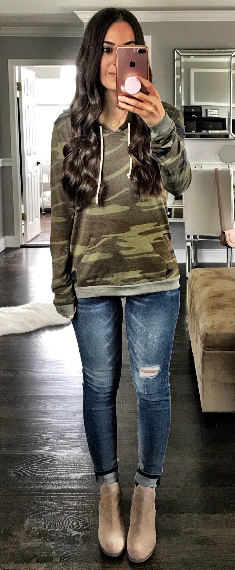 women's woodland camouflage pullover hoodie with blue denim jeans