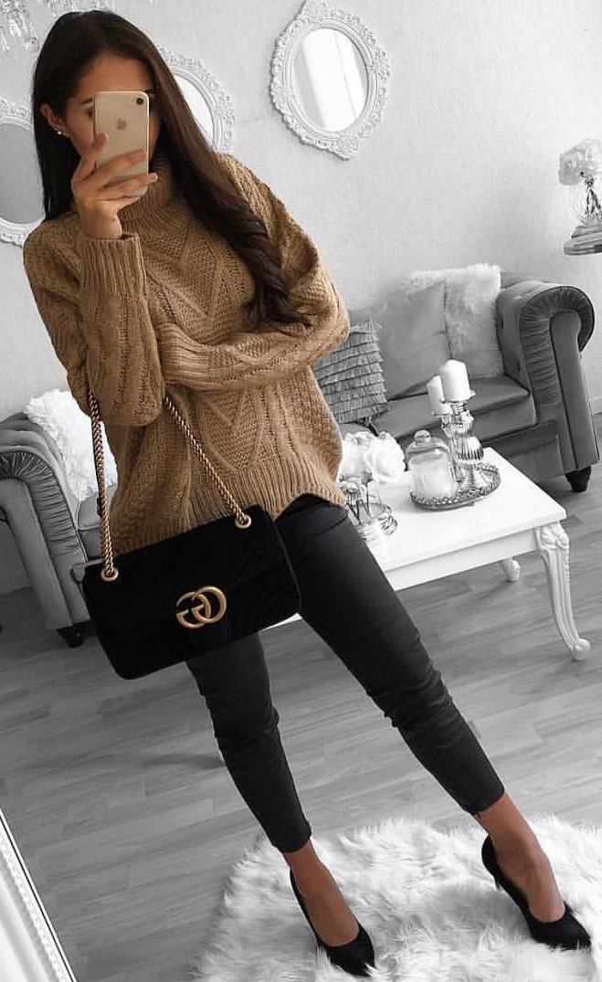 brown knit sweater and black leggings