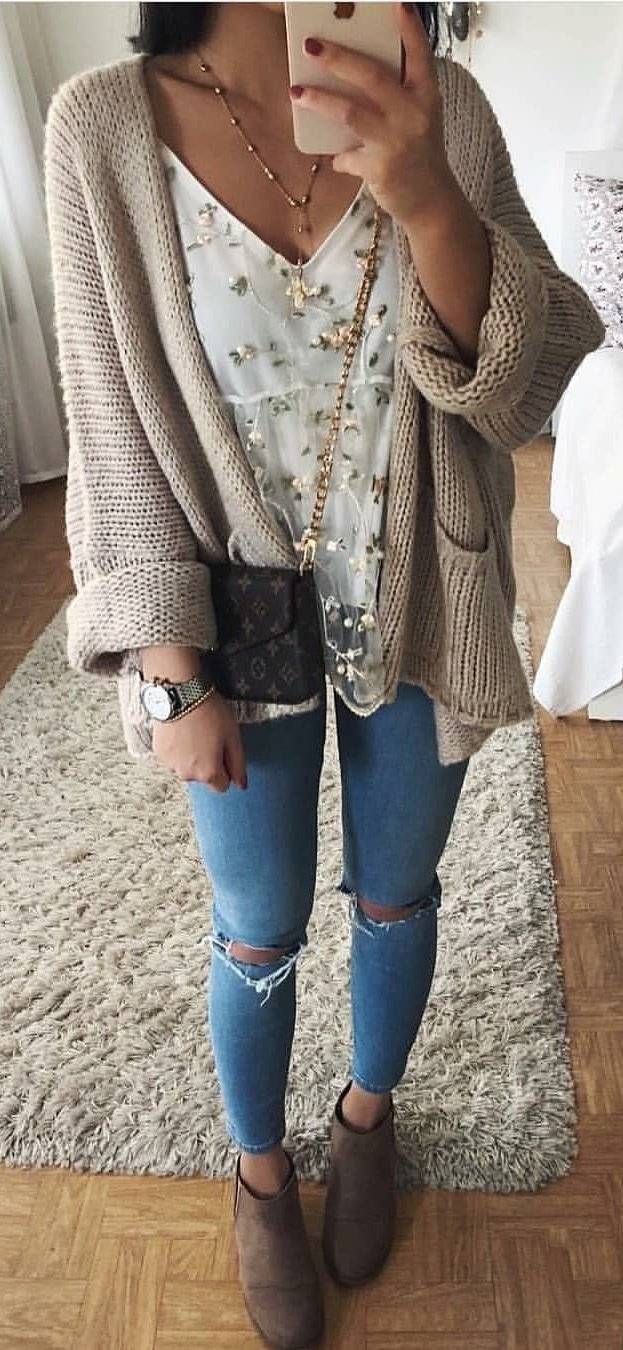 brown knitted cardigan and distressed blue denim pants