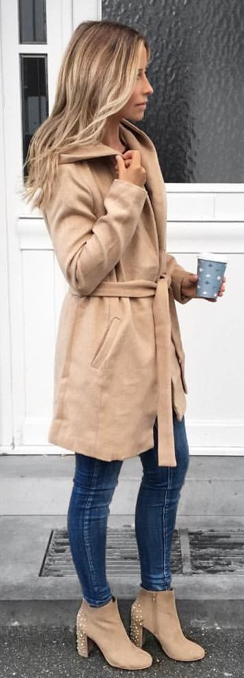 brown overcoat with blue denim jeans and studded brown suede side-zip boots