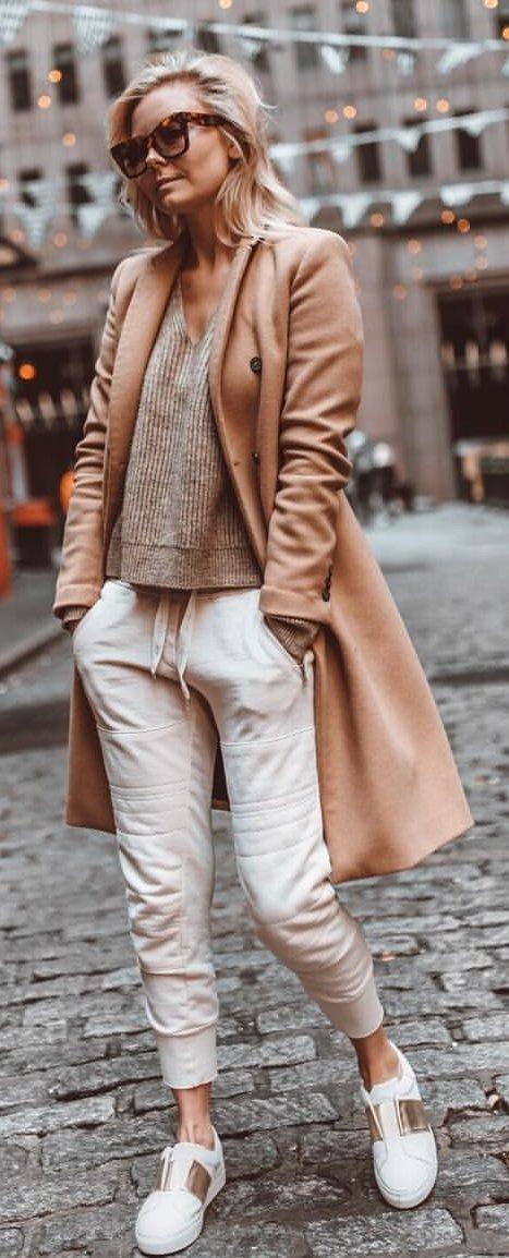 gray v-neck shirt, brown long-sleeved cardigan, and white pants