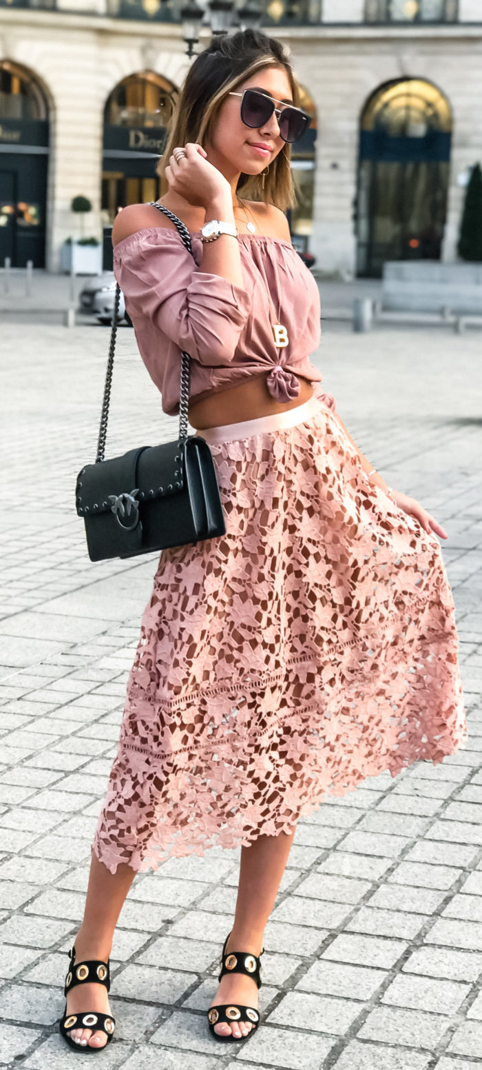 women's black sunglasses, brown off-shoulder crop top, floral midi skirt, and pairs of black sandals outfit