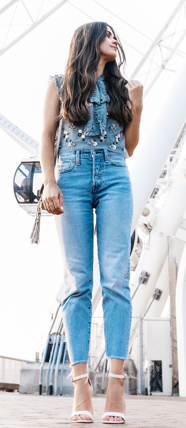 women's blue denim sleeveless top and blue jeans
