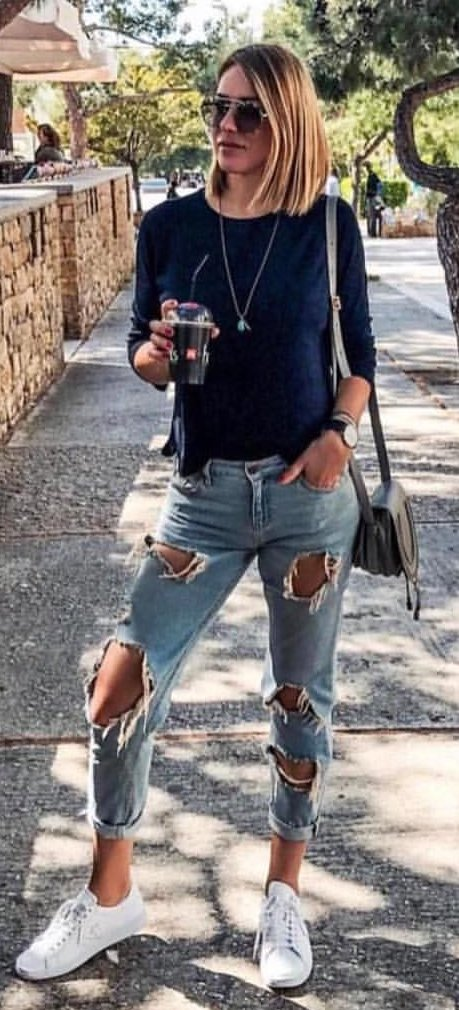 women's blue elbow-sleeved shirt and distressed blue denim jeans