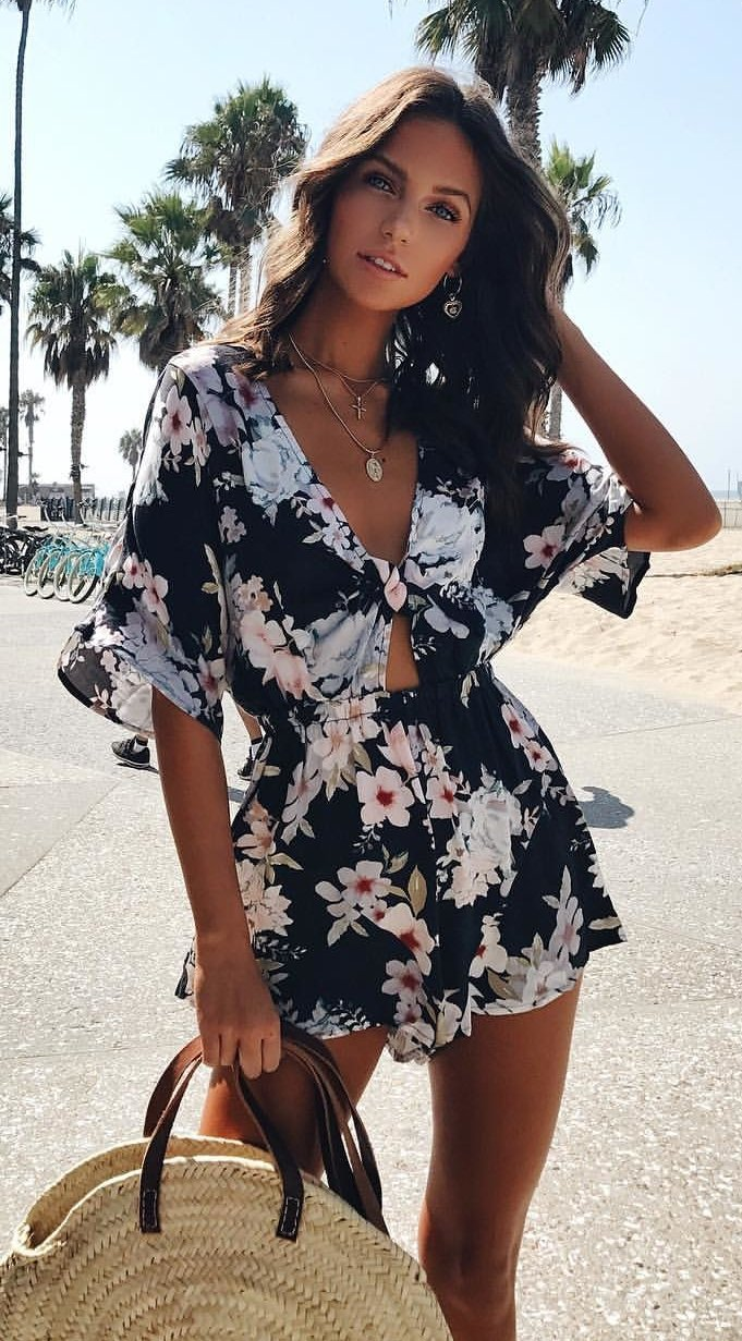 women's white and black floral trumpet sleeved rompers
