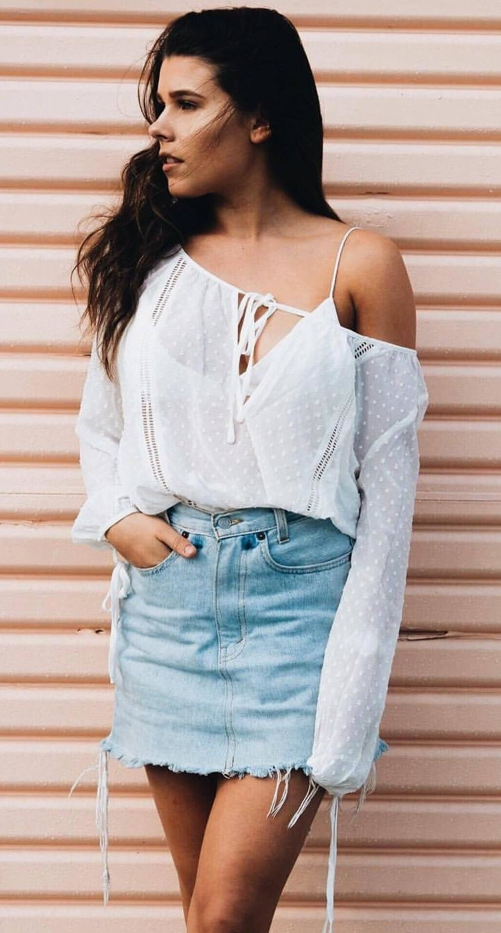 women's white off-shoulder top and blue denim skirt