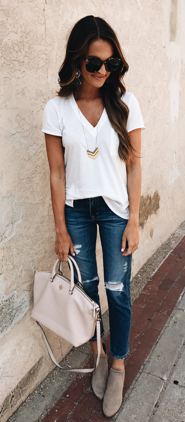 women's white v-neck t-shirt and blue distress denim stone-wash jeans outfit