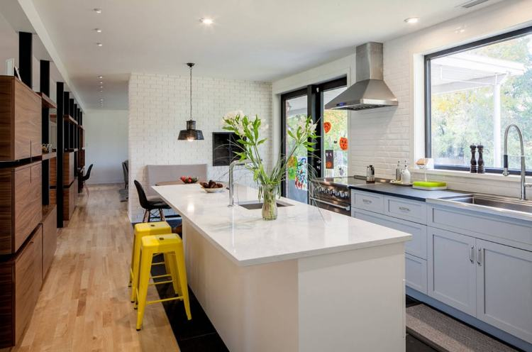 voguish open kitchen with living room that'll keep your