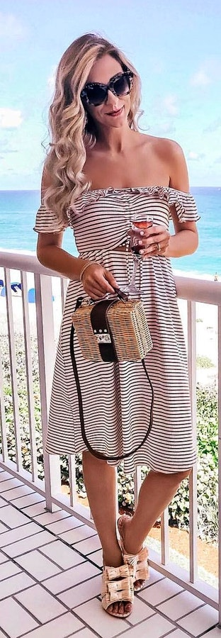 6b6f93fca8a  26 Black and white stripe off-shoulder midi dress + Black Sunglasses +  Handbag. Pic by  apinchoflovely Source