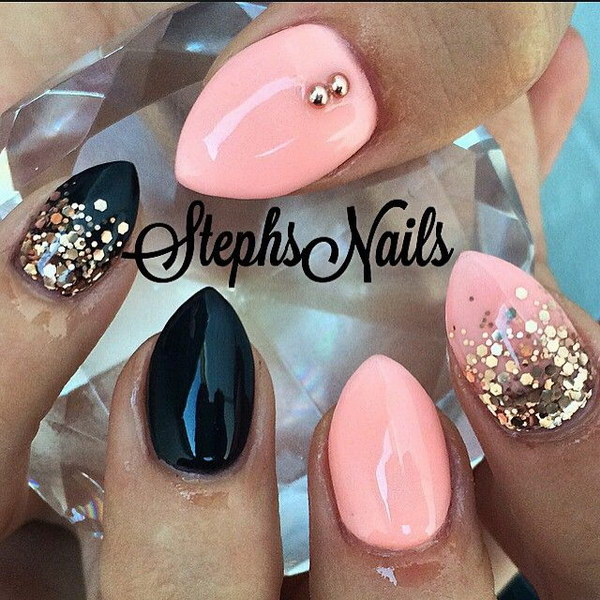 Baby Pink and Black Stiletton Nail with Glitter Accent.