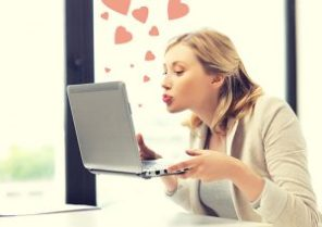picture of woman with laptop computer sending kisses and hearts