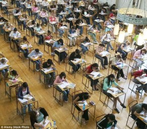 Students sitting in perfect rows taking a test