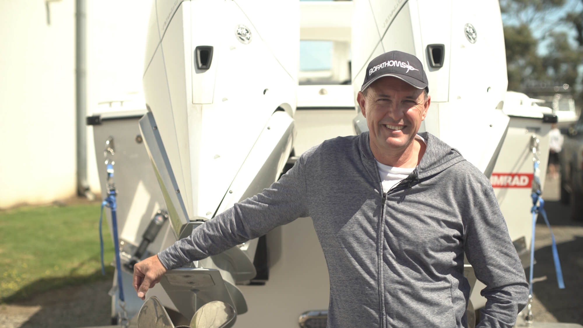 Edencraft owner poses in front of his Edencraft 233 Formula Classic Hardtop with twin 300hp Mercury outboard motors