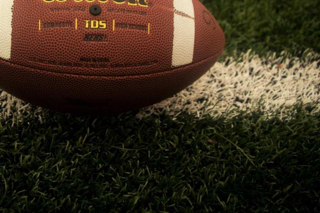Football lying on grass
