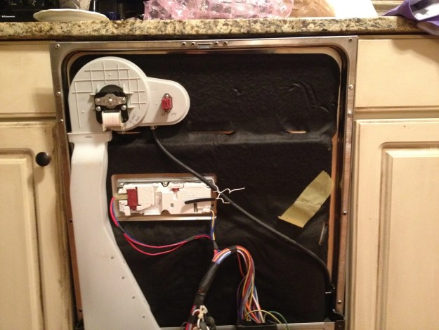 Dishwasher with the door panel and the control panel removed.