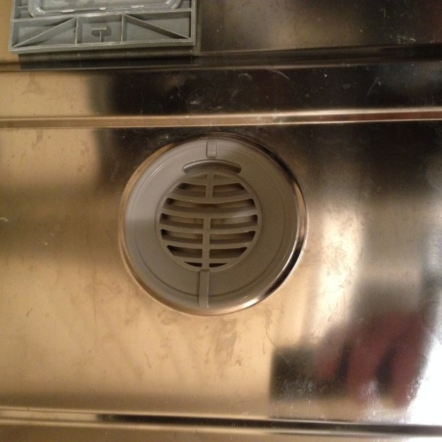 The vent cover on the inside of the door needs to be removed by twisting (or unscrewing) it.
