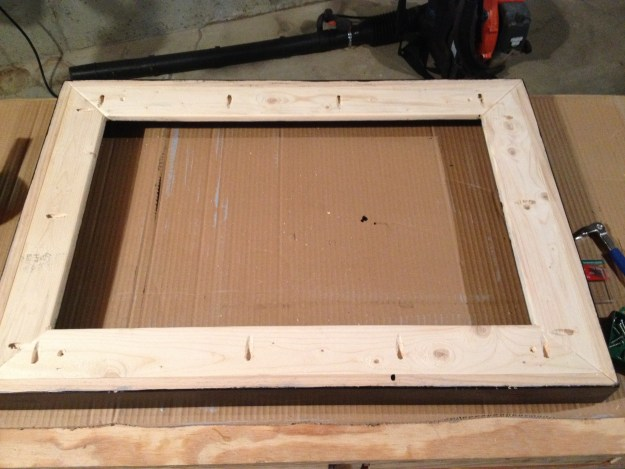 Here's a view of the backside of the frame. You can see the pockethole attachment. Note the countersunk holes at the 4 corners for attaching the canvas.