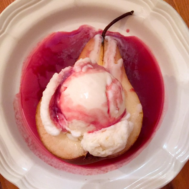 Roasted pear with frozen vanilla yogurt and wine syrup.