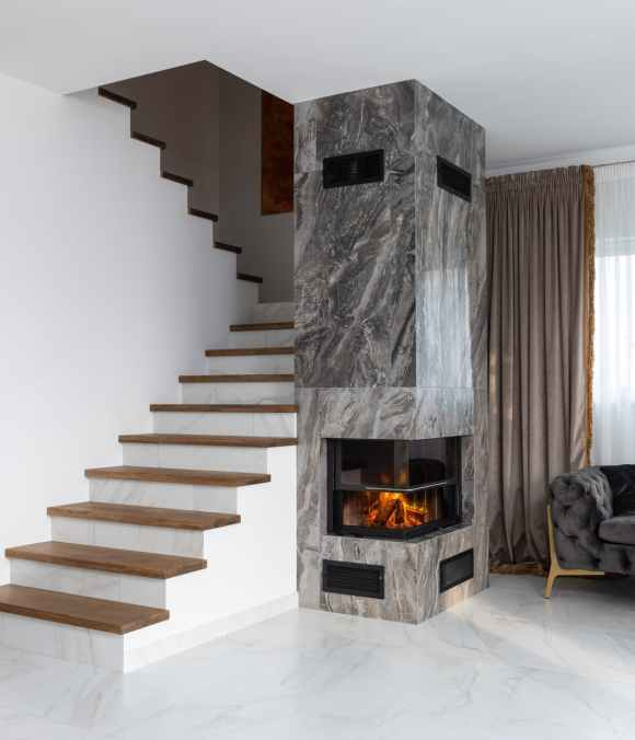 fireplace near staircase in apartment