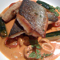 Seared seabass with shellfish bisque. Look - squid rings!