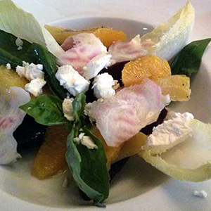 Sweet beetroot, tangy goats cheese, orange and chicory salad.
