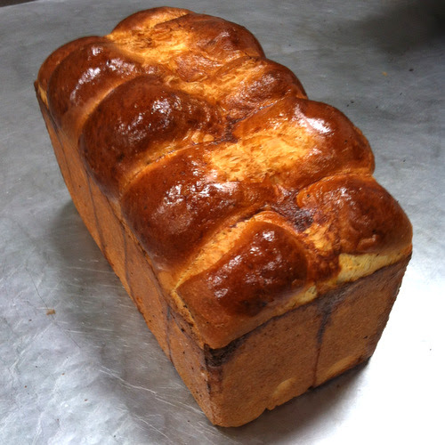 A brioche loaf, created from 10 equal sized balls of dough.