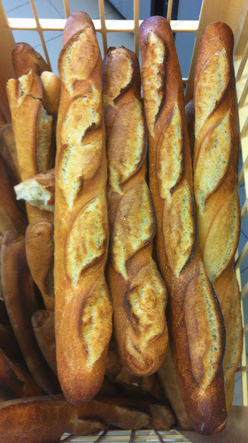Baguettes with sourdough starter added. Not just any old baguettes, but 20% sourdough starter incorporated for extra flavour. I've just noticed someone must have taken a bite out of one!