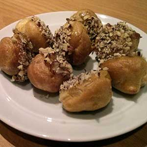 Crunchy caramel nut balls: choux pastry with filling and a crunchy coating