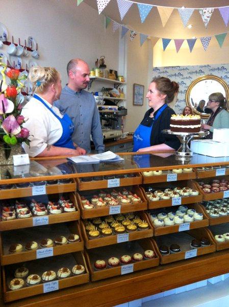 Graham and the bakers with the fabulous display of cupcakes