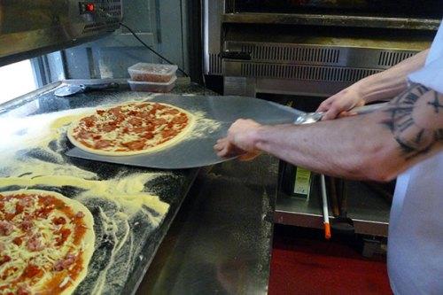 Arturo makes picking up pizza look easy. Civerino's, Edinburgh