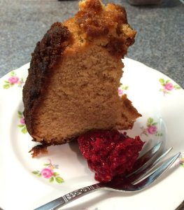 A slice of the maple marzipan cake made in a kugelhopf tin