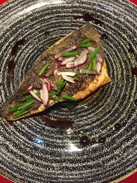 Sea bream fillet, black olive pate, spinach and balsamic vinegar dressing