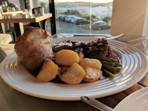 Another view of the roast lamb dinner with a teaser of the view in the background.