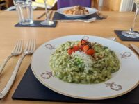 Off-centre but not less tasty for that: wild garlic and asparagus risotto in the front,, cassoulet in the back.