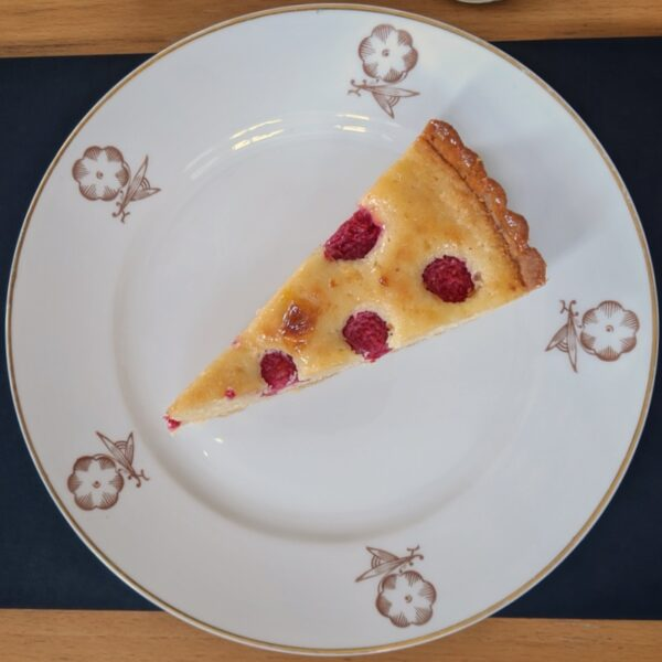 Raspberry and almond tart. Out of shot: créme anglaise.