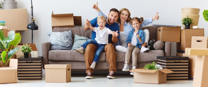Happy family after moving to a new flat