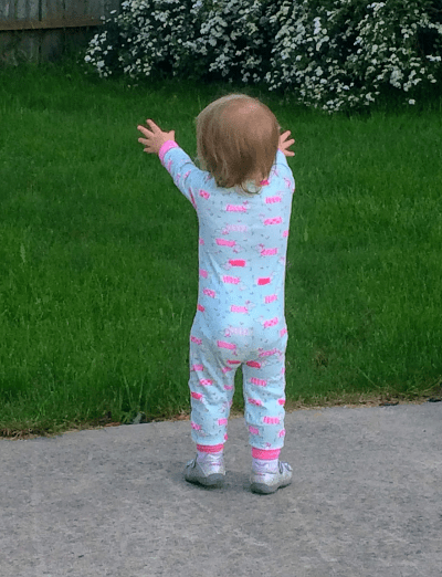 Our daughter reaching out her arms to the crow