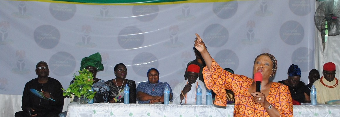 Edo State Attorney General/Commissioner for Justice and Chairperson of the Edo State Task Force on Human Trafficking, Prof. Yinka Omorogbe, speaking at Idogbo, the Headquarters of Ikpoba Okha Local Government Area during the flag-off of a state-wide sensitisation workshop on human trafficking and illegal migration, at the weekend. Behind her are members of the taskforce and other stakeholders in the fight against human trafficking.