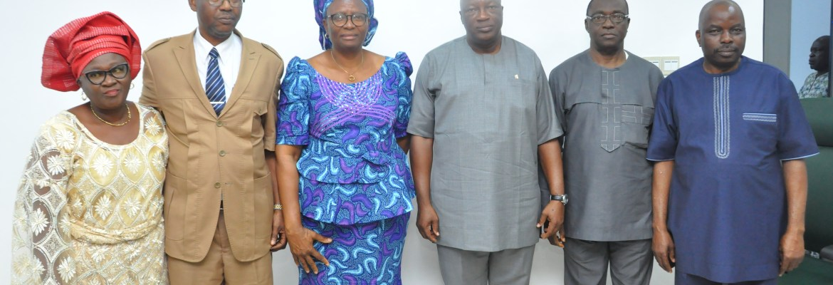 The representative of the Governor of Edo State and Secretary to Edo State Government (SSG), Osarodion Ogie, Esq. (3rd from right); Edo State Head of Service, Mrs. Gladys Idahor (3rd from left); Permanent Secretary, Edo State Government House, Emoedume Bright (right); retired Permanent Secretaries; Mr. Thomas Idahosa (2nd left) with wife; and Rev. Samuel Uhuangho (2nd from right); during an event held at the Government House, Benin City, to mark their retirement.