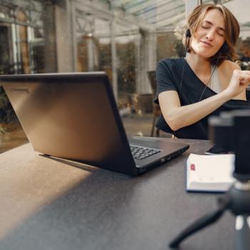 woman having fun while sitting with laptop 4017433