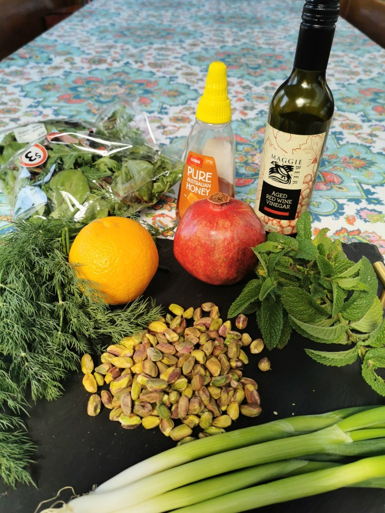 herb, pistachio and pomegranate salad ingredients