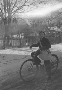 English: A boy on a bicycle with a Toronto Sta...