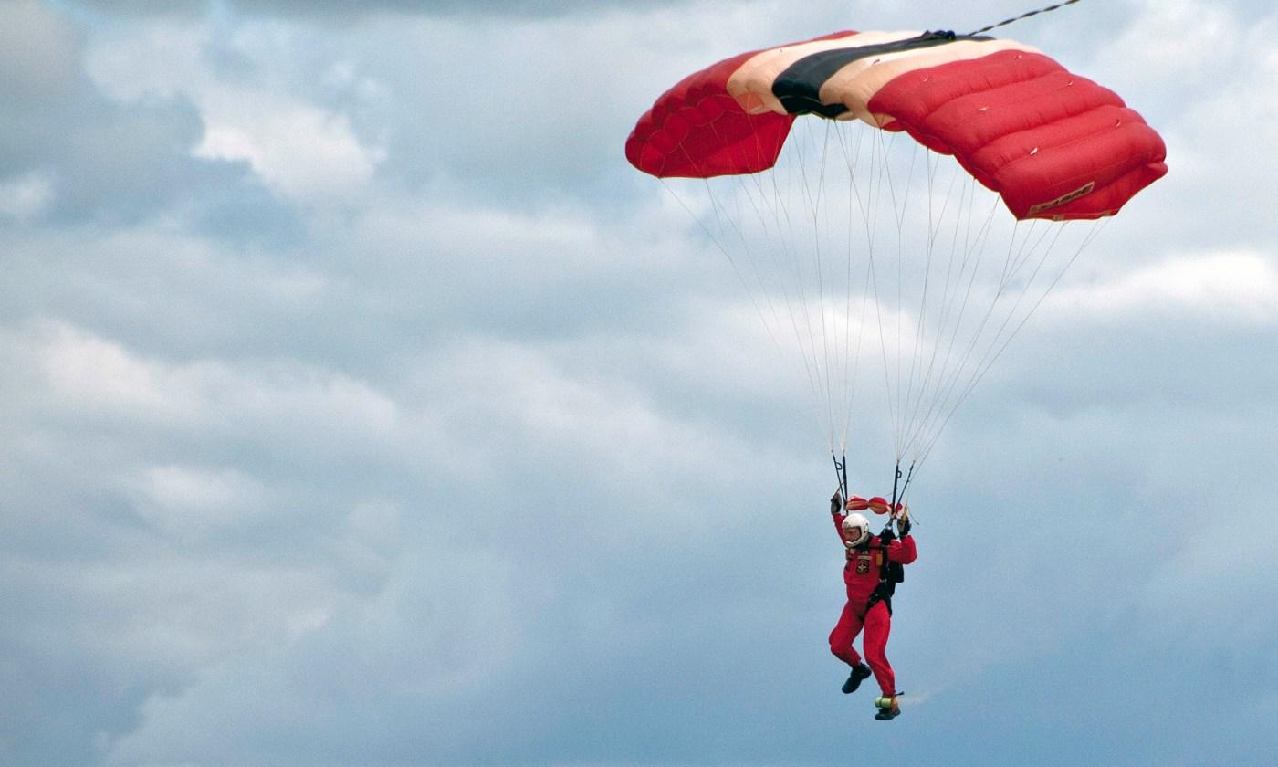 Parachutist coming into land