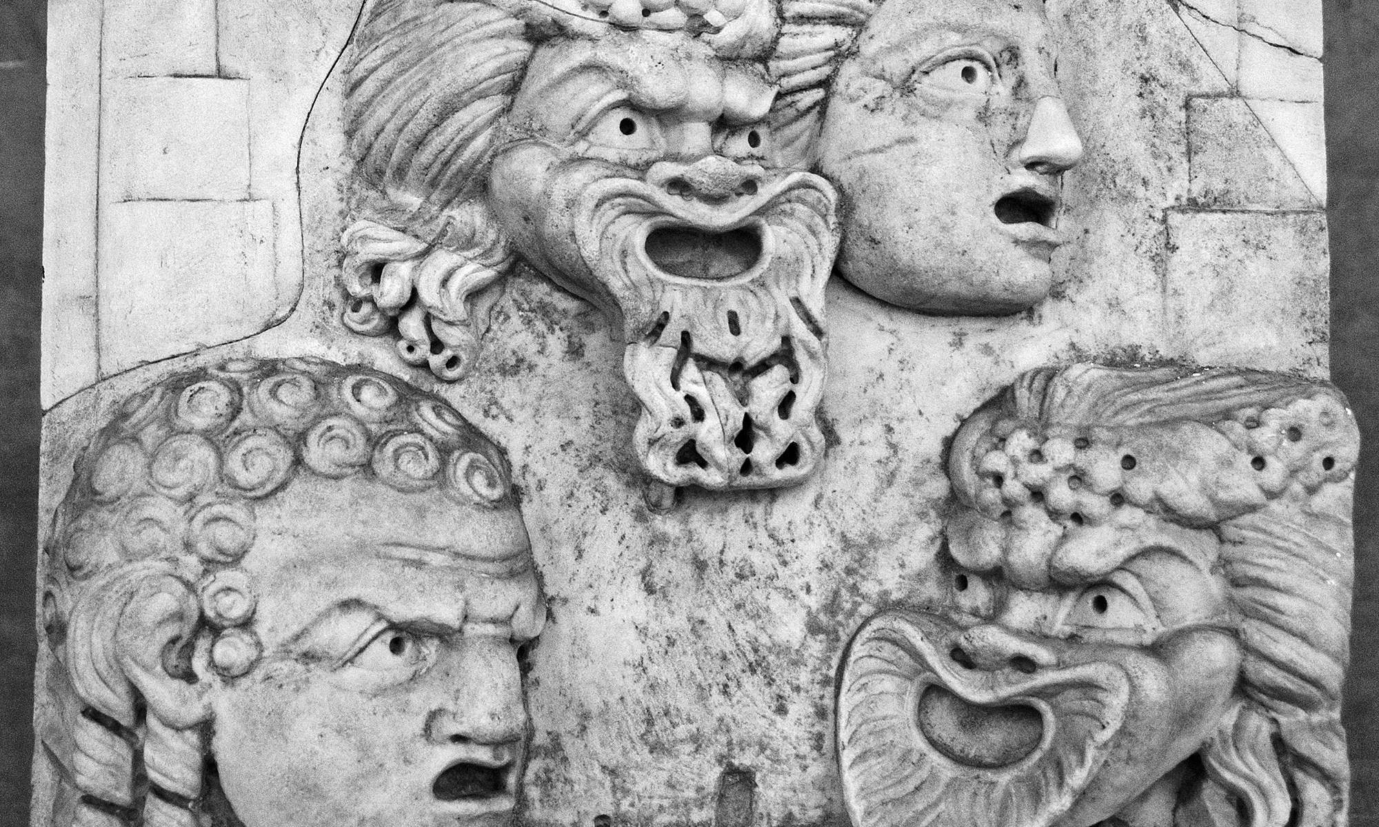 Theatre Masks in Stone Relief