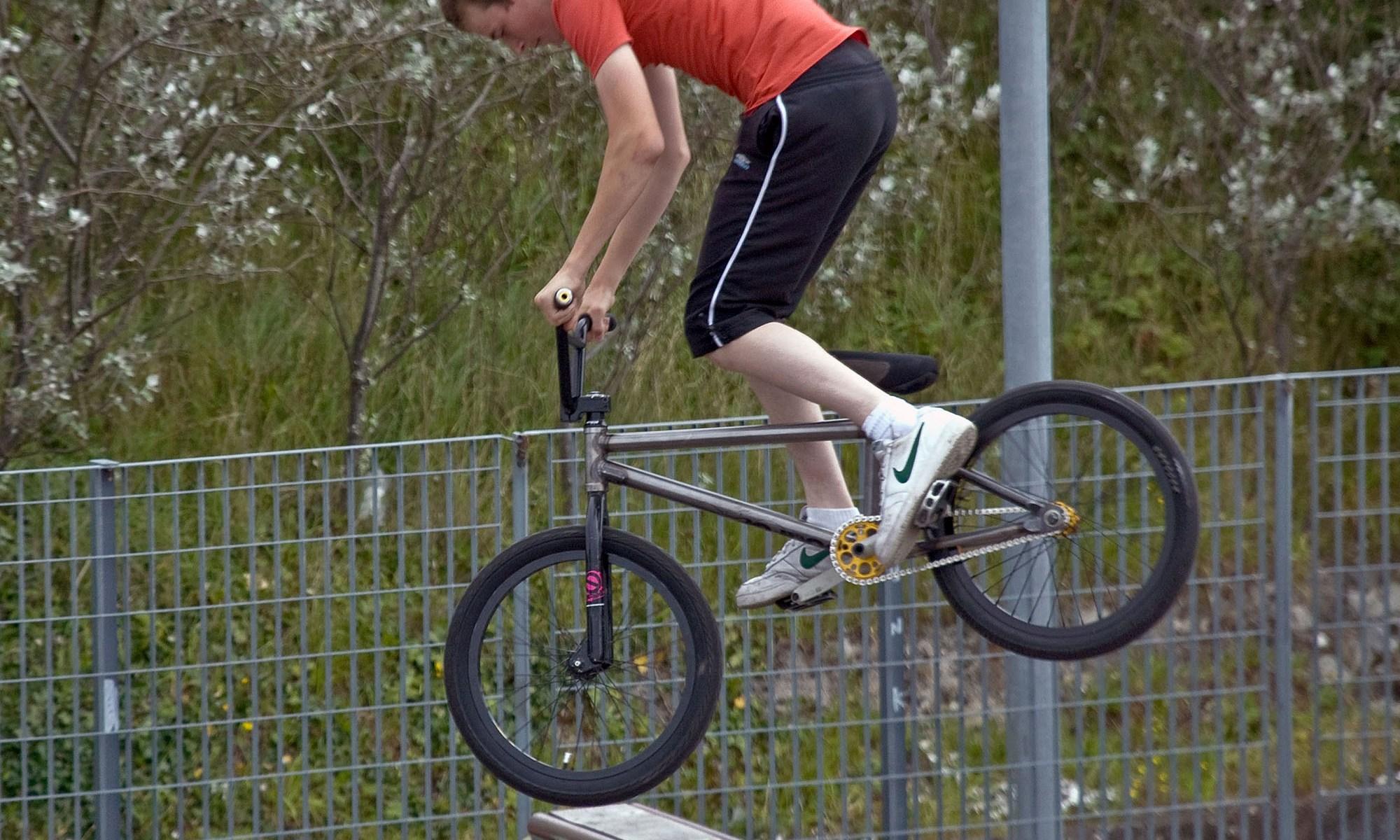 BMX Biker Jumping a Half Pipe
