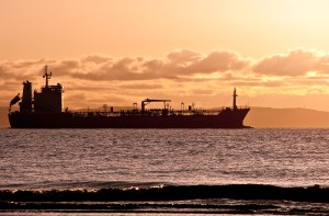 Cargo Ship sailing out of Liverpool at Sunset