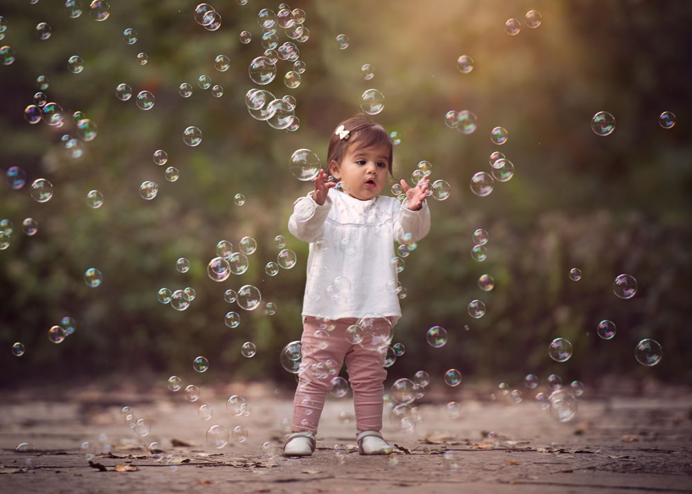 Little girl playing with bubbles in Lincoln Park Chicago