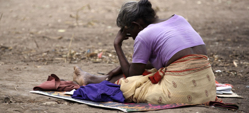 A Tamil woman sits on the ground in the Manik Farm refugee camp located on the outskirts of northern Sri Lankan town of Vavuniya