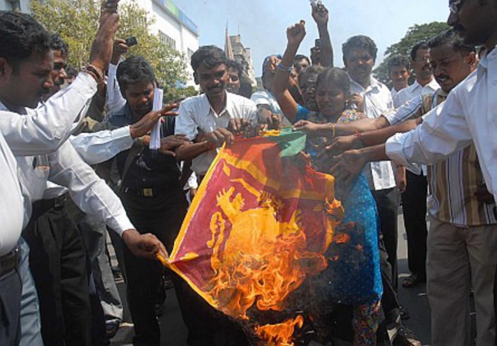 People burning the Sri Lankan flag
