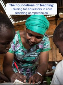 Toolkit cover page. Photo shows female teaher learning over desk writing, with child either side of her